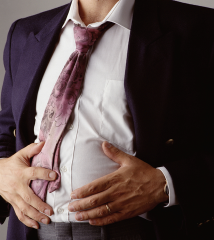 Man suffering from low stomach acid