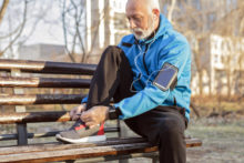 Man tying his shoes before exercising