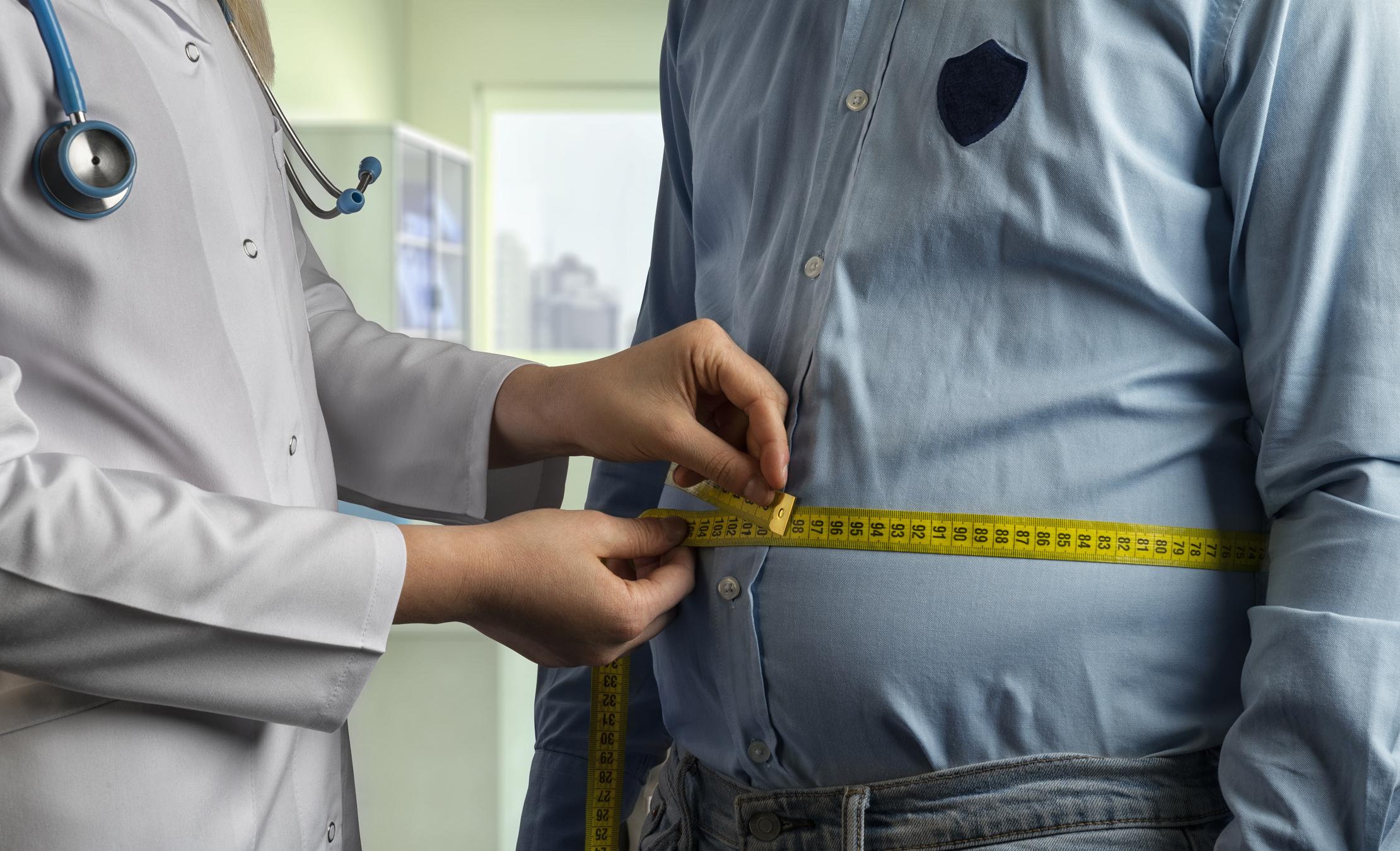 A doctor working with an overweight patient on his health