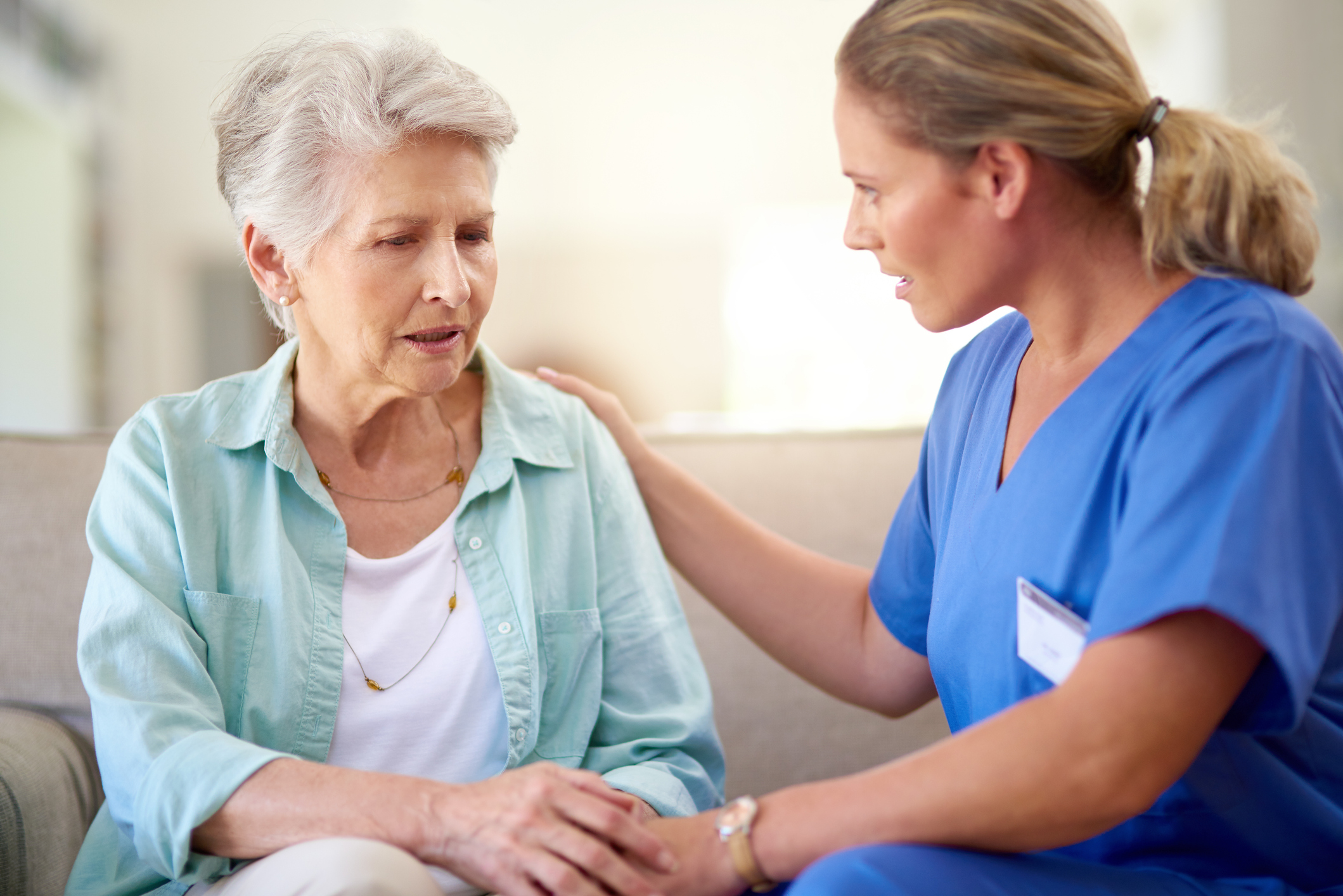 A caregiver working with nursing home patient
