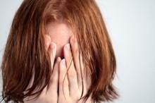 Woman needing a constipation remedy