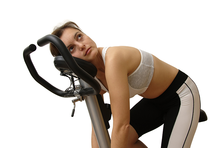 Woman resting after exercise and wondering how much exercise is too much