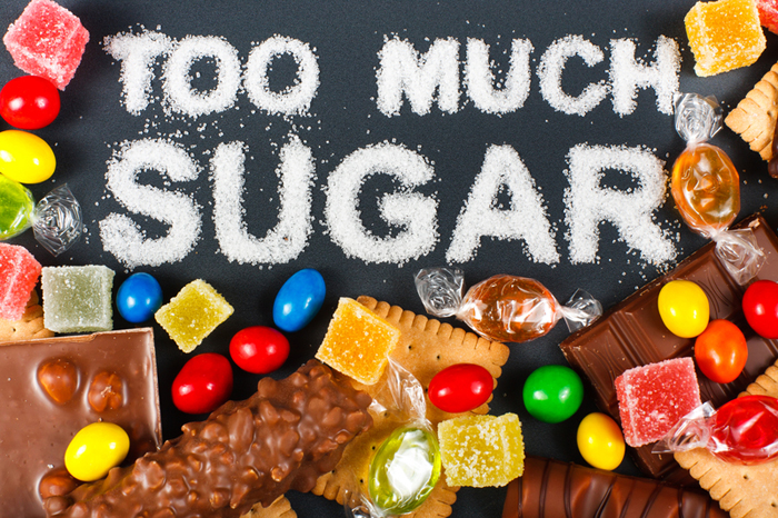 Too much sugar written out in sugar surrounded by candy
