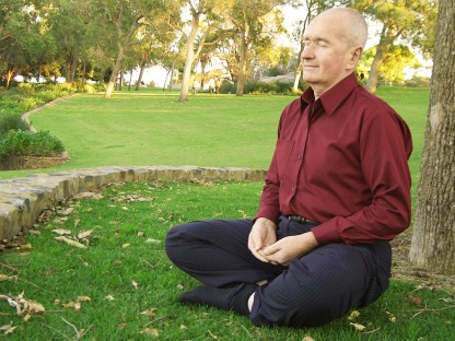 Man sitting under a tree enjoying natural pain relief