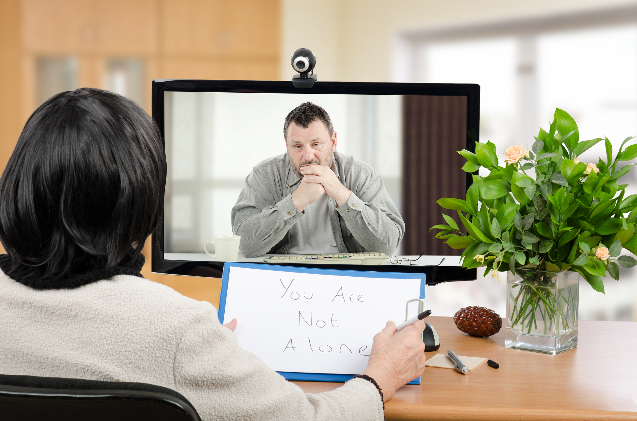 Man doing an online therapy session