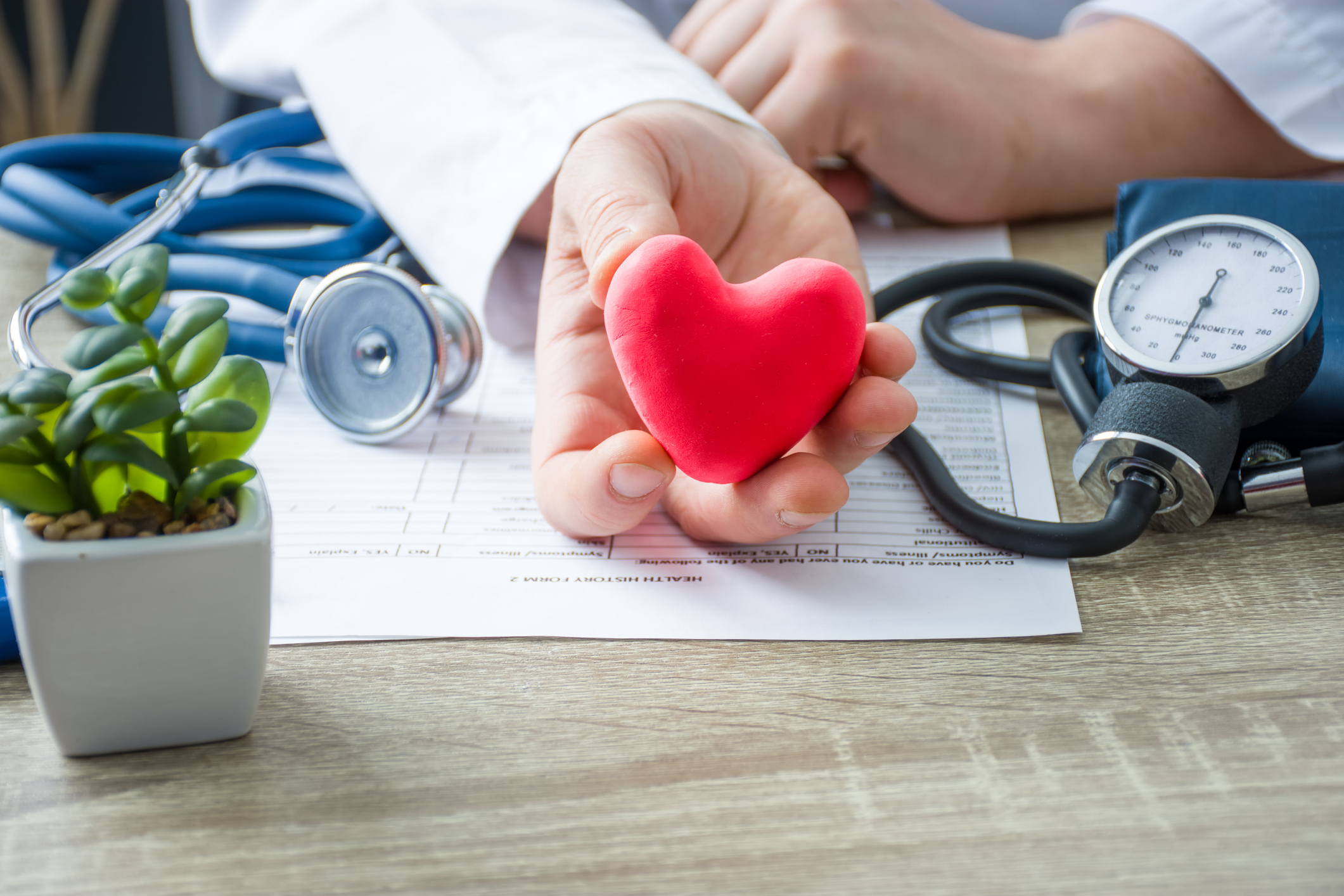 Doctor holding a heart to illustrate heart health