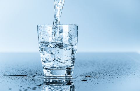 a glass of water to help stay hydrated